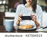 woman taking photo food concept | Shutterstock . vector #437504515