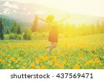 happy traveler man jump on the... | Shutterstock . vector #437569471