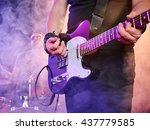 rock band performs on stage.... | Shutterstock . vector #437779585