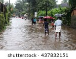 Small photo of ARANMULA, INDIA - AUG 05:Unidentified people walk on the flood water on August 05,2013 in Aranmula,Kerala, India. Kerala is the most rain affected state on south west monsoon in India