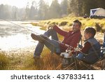 Father And Son Fishing By A...