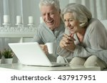 happy senior couple with laptop | Shutterstock . vector #437917951