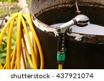 yellow water hose with nuzzle... | Shutterstock . vector #437921074