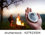 hand holding a compass and... | Shutterstock . vector #437923504