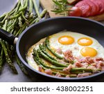 fried eggs with asparagus  ham... | Shutterstock . vector #438002251