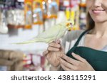 Smiling Saleswoman With...