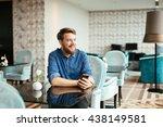 handsome man using phone in... | Shutterstock . vector #438149581