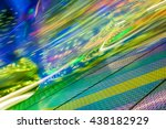 Small photo of Varicolored light streaks of a spinning amusement ride at the funfair; Impressions from the fairground; Colorful illumination for background