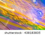 Small photo of Colorful light streaks of a spinning amusement ride at the fairground; Impressions from the funfair; Colored illumination for background