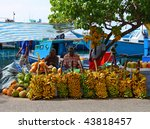 MALE - JULY 1: Three street vendors sit by bananas stall - Market situated on the harbor of Male - capital of Maldives - July 1, 2009 - Male - Maldives. - stock photo
