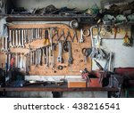 old tools hanging on wall in... | Shutterstock . vector #438216541