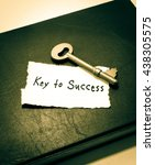 Small photo of Key to success. Key with a success tag