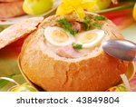 white borscht with eggs and sausage in bowl of bread for easter - stock photo