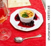 hot creme brulee dessert with spearmint on a dish - stock photo