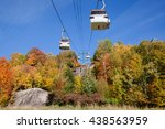 Small photo of Lush boreal forest view of Mont Tremblan (trembling mountain), Laurentian mountains. Panoramic gondola cableway.