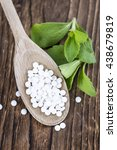 Small photo of Stevia sweetener pills (selective focus) on wooden background