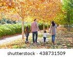 family walking in an autumn... | Shutterstock . vector #438731509