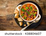 chili con carne on a wooden... | Shutterstock . vector #438804607