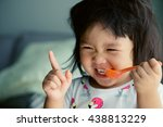 happy little asian girl eating... | Shutterstock . vector #438813229