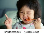 happy little asian girl eating... | Shutterstock . vector #438813235