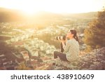 female traveler photographer... | Shutterstock . vector #438910609