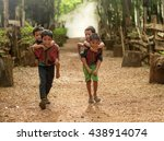 Stock photo child boy tribal playing ride back merrily 438914074