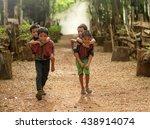 Stock photo child boy tribal playing ride back merrily 438914074