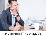 Sick Man Sitting At The Table