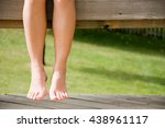 woman hanging leg on balcony   Shutterstock . vector #438961117