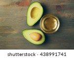 Fresh Avocado Oil On Wooden...