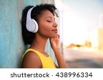 pretty girl listening music... | Shutterstock . vector #438996334