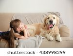 Little Girl And Big Kind Dog O...