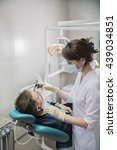dentist doctor puts on the... | Shutterstock . vector #439034851
