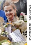 Small photo of London, United Kingdom - June 18, 2016: Jo Cox. An impromptu memorial site in Parliament Square, to Jo Cox the murdered MP, remains a place for people in London to come to, to mourn her loss.