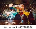 Stock photo barman show bartender pours alcoholic cocktails 439101094