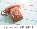 retro orange red telephone on... | Shutterstock . vector #439148617
