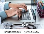 practitioner typing on laptop... | Shutterstock . vector #439153657