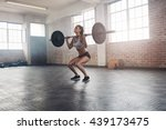female bodybuilder doing... | Shutterstock . vector #439173475