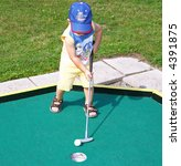 Young golfer - stock photo