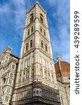Small photo of Florence, Italy - June 2015 - Giotto's Campanile adjacent to the Basilica of Santa Maria del Fiore.