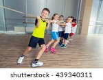 group of kids pulling a rope in ... | Shutterstock . vector #439340311