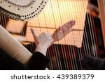 Hands Of The Woman Playing A...