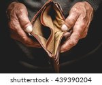 empty wallet in the hands of an ... | Shutterstock . vector #439390204