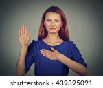 young woman making a promise... | Shutterstock . vector #439395091