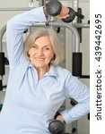 elderly woman exercising in gym | Shutterstock . vector #439442695