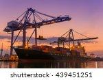 cargo ship terminal at twilight ... | Shutterstock . vector #439451251