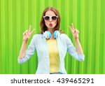 pretty cool woman listens to... | Shutterstock . vector #439465291