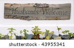 Husbands Welcome Sign - stock photo