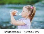 girl drinks water from a bottle ... | Shutterstock . vector #439563499
