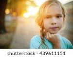 little beautiful calm girl on a ... | Shutterstock . vector #439611151